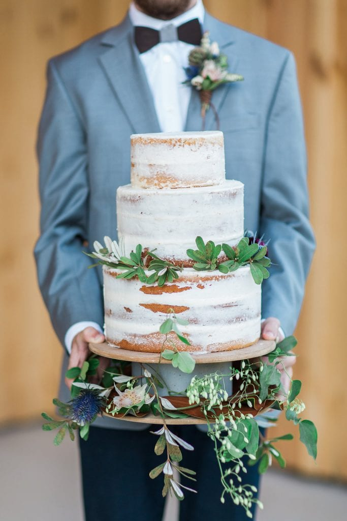 Groom with Catered Wedding Cake – Country Lane Lodge
